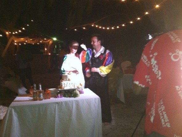 Lisa and Alex cutting there wedding cake