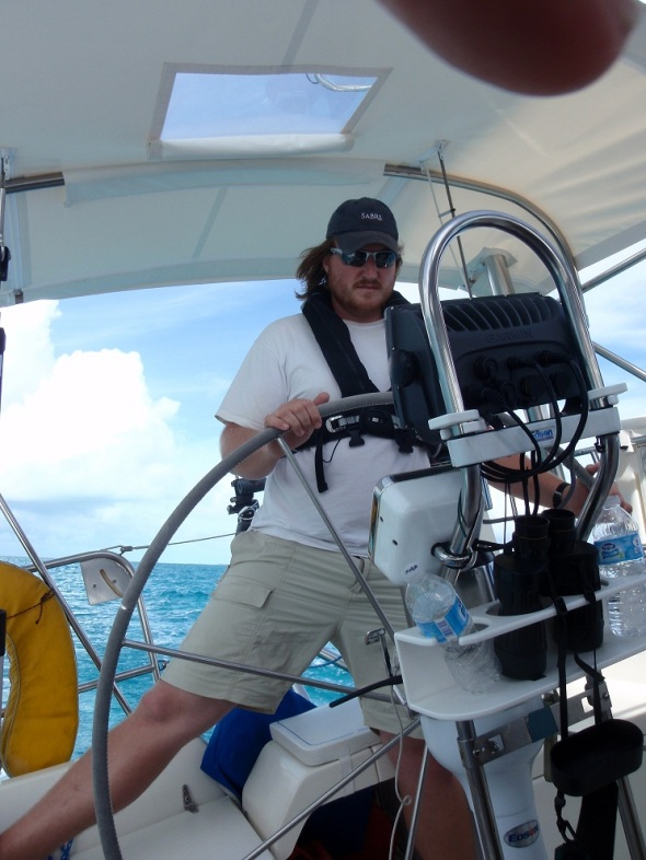 Me at the helm on our way to the Exuma Park