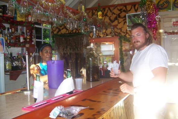 Trying a local rum shot which came from the jug behind me with all the stuff in it. I wont lie it tasted like a shot of potpourri.