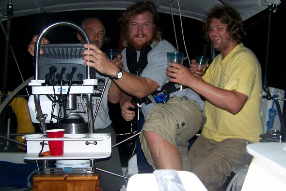 Picture of us as we crossed the Equator with a shot of RUM! I almost made it behind the helm before the camera went off!