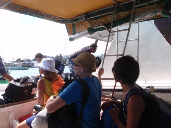 Boarding from water taxis into the ferry boat.