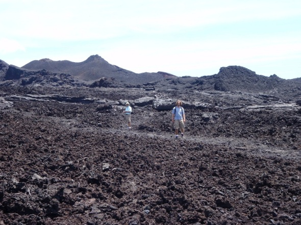 Dale and Adam walking i the lava fields