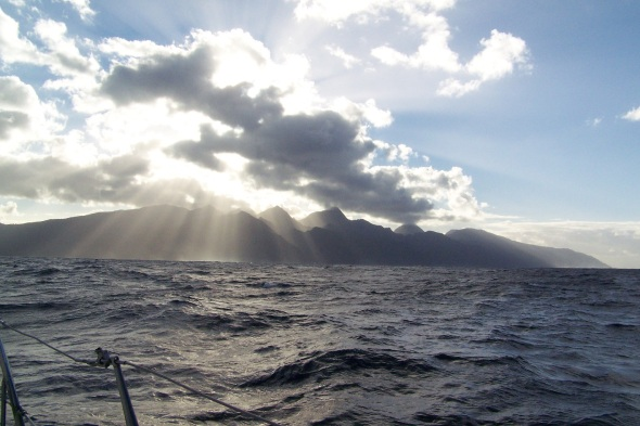 As the sun rose over South Tahiti it shined over the mountains that rise 4500 feet above sea level and the sunlight warmed my face as we searched the reef breakers for our narrow passage into the anchorage as Adam slept below.  It was a cold night became its winter here, almost 75 degrees last night!