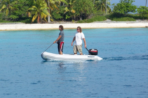 Adam and I went to shore and my dad took this picture of us looking into the water for coral heads that are near the surface. You had to weave around them so you would not rip a hole in the dinghy or damage the outboard motor.