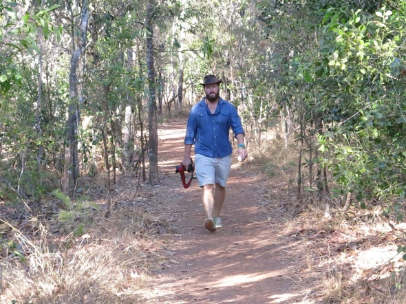 Carry the pro at work in the Northern Territory national park taking pictures.