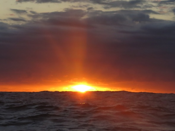 After leaving Mauritius Island the sun tried to set the ocean on fire.