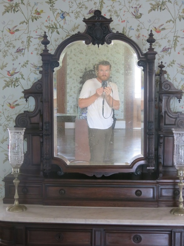 I thought it was cool to look into a mirror in this old Cheatue and capture myself in a mirror that captured the pasts of others because it was the original furniture of the building.